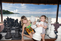Children play chess nearly sea. Stock Photography