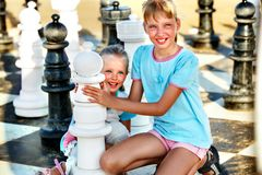 Children play chess outdoor. Royalty Free Stock Images