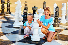 Children play chess outdoor. Royalty Free Stock Image