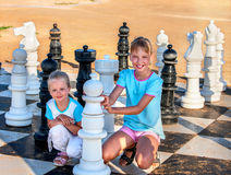 Children play chess outdoor Stock Images