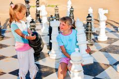 Children play chess outdoor Royalty Free Stock Images