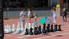 Children play in the chess in the village of Rosa Khutor, Sochi Stock Photography