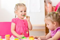 Children with play clay indoors royalty free stock images