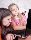 Children play at the computer. Children are engaged at the computer in homework Royalty Free Stock Images
