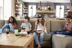 Children Play Computer Game Using Virtual Reality Headset Stock Image
