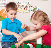 Children play construction set . Royalty Free Stock Photography