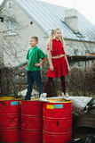Children play at dump drums Stock Photo