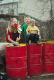 Children play at dump drums Royalty Free Stock Photos
