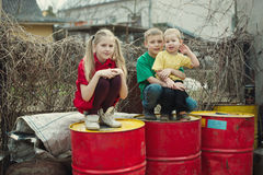 Children play at dump drums Stock Images