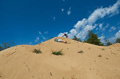 Children play on the dunes Stock Photography