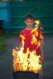 Children play with fire in the grill Stock Photography