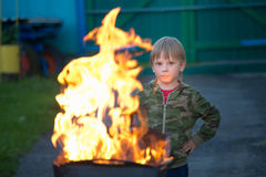 Children play with fire in the grill Stock Image