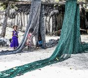 Children Playing with Fish Nets in Zanzibar royalty free stock images