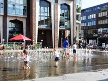 Children play at a floor fountain Royalty Free Stock Photos
