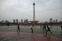 Children play football in Jakarta, Indonesia. Royalty Free Stock Photos