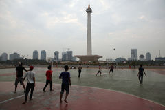 Children play football in Jakarta, Indonesia. Royalty Free Stock Photo