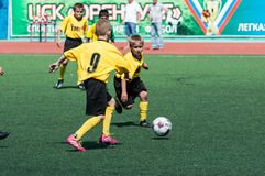 Children play football. Orenburg, Russia - 22 May 2015: Children play football at the competition Lokobol-2015 Stock Photo
