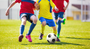 Children play football. Soccer football game for youth Royalty Free Stock Photo