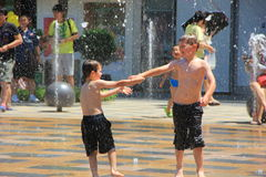 Children play a fountain Royalty Free Stock Photo