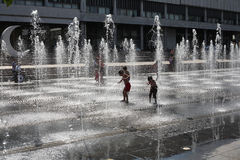 Children play in the fountain Royalty Free Stock Photos