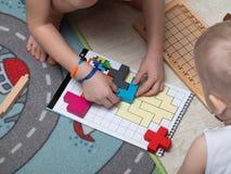 Children play a fun Board game where hippos eat balls. reaction games. educational games for children. children`s hands