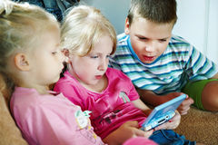 Children play on game console Royalty Free Stock Photos