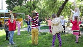 Children play game in kindergarten stock video