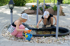 Children play in the garden. Boy and girl play in the garden in summer Stock Image