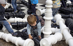 Children play giant chess at Moscow City Day Celebrations Royalty Free Stock Photography