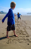 Children Play Hopscotch on Beach stock photography