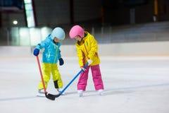 Children play ice hockey. Kids winter sport. royalty free stock photo