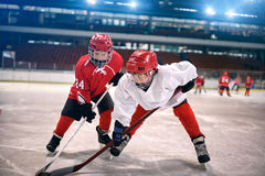 Children play ice hockey Royalty Free Stock Image