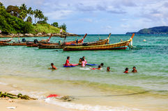 Free Children Play In Sea Near Boats, Phuket, Thailand Royalty Free Stock Image - 72122086