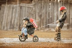 Free Children Play In The Rider And The Rocketman Royalty Free Stock Image - 215286116