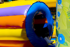 Children play on the inflatable children`s playground Stock Image