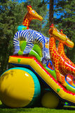 Children play on the inflatable children`s playground Stock Photography