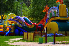 Children play on the inflatable children`s playground Royalty Free Stock Images