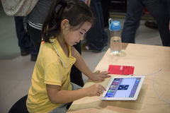 Children play ipad. At Apple Store in Shenzhen, China Stock Image
