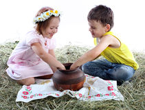 Children play with a jug Royalty Free Stock Photo