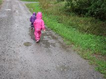 Children play and jumping in muddy puddle. Series of children play and jumping in muddy puddle royalty free stock images