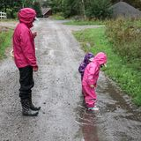 Children play and jumping in muddy puddle stock image