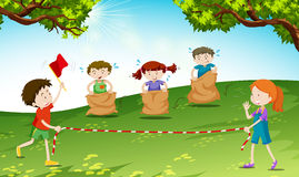 Children play jumping sack in the park Stock Image
