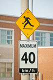 Children at Play and Maximum 40 km/h Signs. Two signs on a pole in front of a school Royalty Free Stock Photo