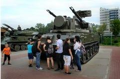 Children play military equipment near the shopping center `Shchelkovo`. stock photography