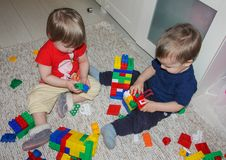Children play in a multi-colored construct, puzzle. A little boy. And girl collect a designer. Children in toys Royalty Free Stock Photos
