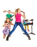 Children play musical instruments and girl sings. Four kids playing on musical instruments together as rock group and girl singing as vocalist in front on white Stock Images