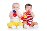 Children play musical toy. Funny children playing musical toy royalty free stock images