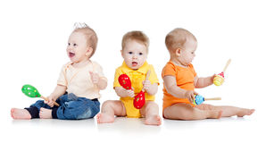 Children play with musical toys stock images