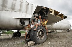 Children's Playground. Children play near a wrecked airplane abandoned in a dumpsite in Paranaque City, south of Manila, Philippines stock photography