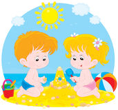 Children Play On A Beach Stock Images